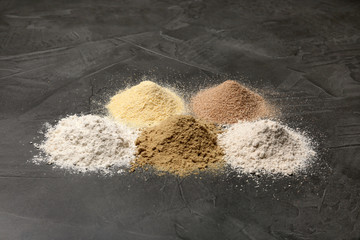 Piles of different flour types on grey table