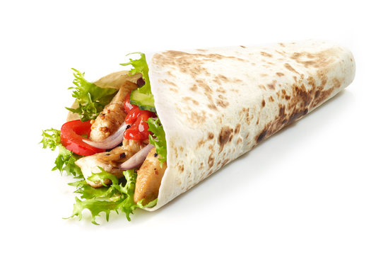 Tortilla wrap with fried chicken meat and vegetables