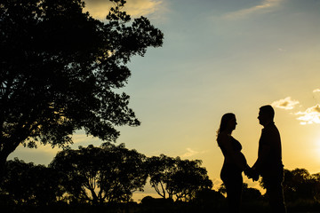 silhouette of man and woman on sunset