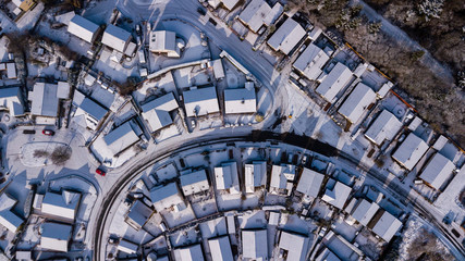 Top down aerial view of roads and houses covered in fresh snowfall (Ebbw Vale, Wales, UK)