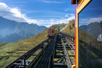 Tourist mountain tram, the transporation to Fansipan cable car station in Sapa town, Vietnam, with mountain landscape scene Wall mural