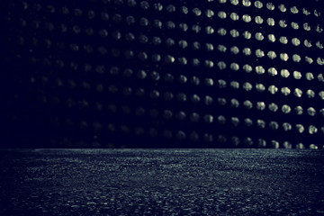 Spotlight over concrete floor. dark black background