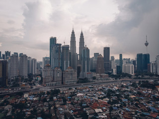 KUALA LUMPUR, MALAYSIA - November 12. Petronas Twin Towers at evening in Kuala Lumpur. Petronas Twin Towers were the tallest buildings (452 m) in the world from 1998 to 2004. overcast weather
