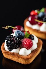 Fresh homemade fruit tart with cherry, blueberres and raspberries