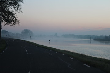 Fog during sunrise over the river Hollandsche IJssel in Moordrecht the Netherlands,