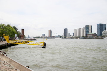 The river Nieuwe maas divding the center of Rotterdam in two parts and used for harbor transports from the port to the inland