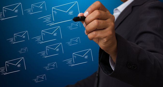 businessman writing icon email on a screen