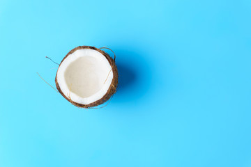 summer background, tropical beach, vacation, fruit minimal concept. creative layout of coconut on bright blue background with copy space