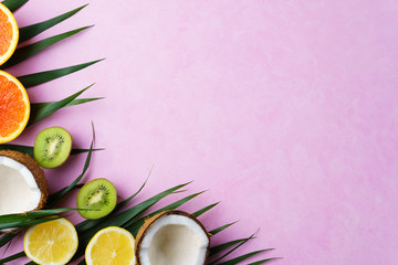 summer composition with exotic fruits and palm leaves on pastel background. summertime vacation, cocktail, tropical beach. creative layout, banner or poster template with copy space for text design