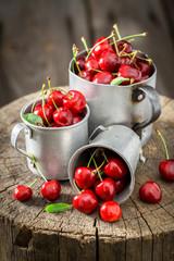 Fresh sweet cherries in the old metal mug