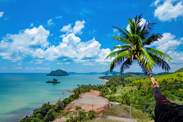 The beauty of coconut trees and the islands in the sea and sky at  Sairee Sawee Beach , Chumphon Thailand.
