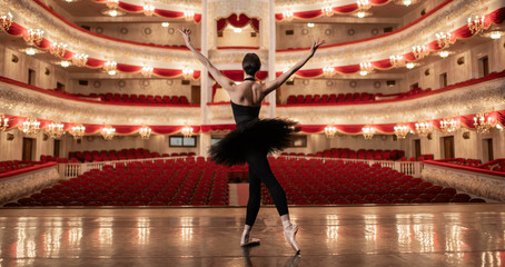 Ballerina standing on stage of amazing theatre and lookng at the auditorioum