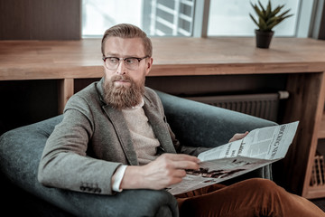 Serious male person having rest after meeting