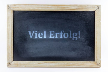 "blackboard with the german words ""Viel Erfolg!"" which means ""I wish you success"""