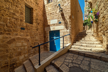 Narrow street and old walls in Jaffa, Israel.