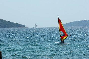 A picture of a windsurf on the sea during the hot summer day. Pictured in Croatia.