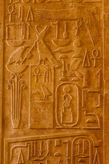 Egyptian ancient hieroglyphs on the stone wall