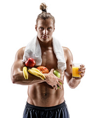 Resting time. Handsome muscular man with towel on shoulders holding fresh fruits and orange juice on white background. Organic food and health concept