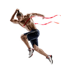 Man running, crossing finish line. Photo of young man isolated on white background. Sport and healthy lifestyle. Dynamic movement. Competition event. Full length