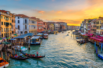 Wall Mural - Grand Canal with gondolas in Venice, Italy. Sunset view of Venice Grand Canal. Architecture and landmarks of Venice. Venice postcard
