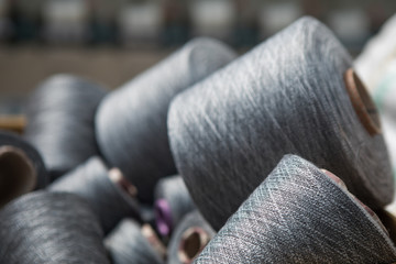 Yarn threads spools of thread bobbin tubes. Textile background concept image Fototapete