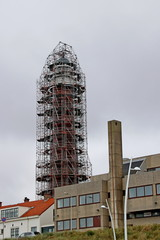 The lighthouse of Scheveningen with scaffolds around it for renovation