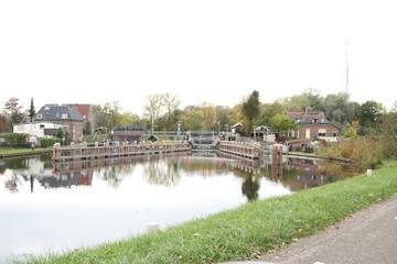 Sluice in the river Hollandsche IJssel named goejanverwellesluis in Gouda where tides in river stops