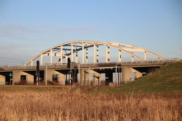 Steel suspension bridge on motorway A20 over the railroad tracks between Gouda, The Hague and Waddinxveen