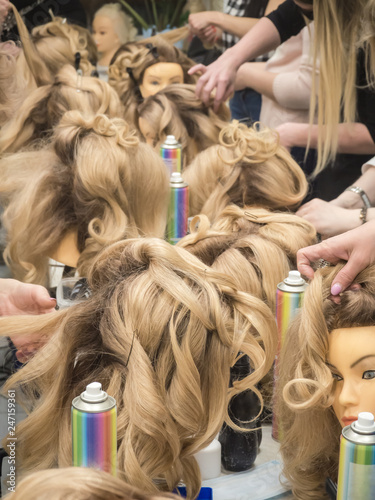 Training Hairstyles On The Mannequin Teamwork Stock Photo And