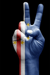 and making victory sign, Cape verde  painted with flag as symbol of victory, win, success - isolated on black background