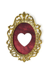 Vintage picture frame and heart ornament isolated on white background