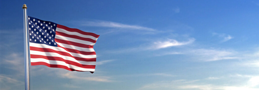 Flag of United States of America rise waving to the wind with sky in the background