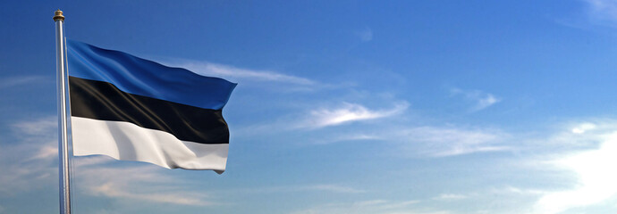 Flag of Estonia rise waving to the wind with sky in the background