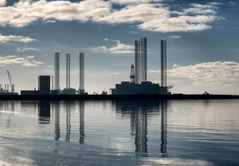 Esbjerg offshore oil harbor in silhouette on a sunny cool day, Denmark
