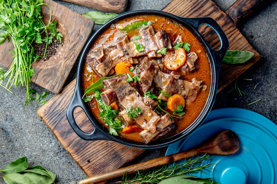 Beef ribs Bourguignon. Beef ribs stewed with carrot, onion in red wine. France dish. Top view