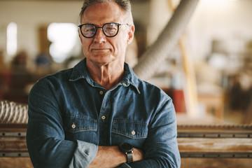 Proud carpentry workshop owner