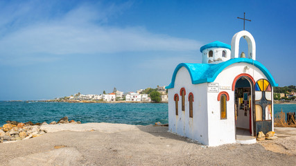 Colorful greek orthodox chapel by the sea near Chania in Crete, Greece