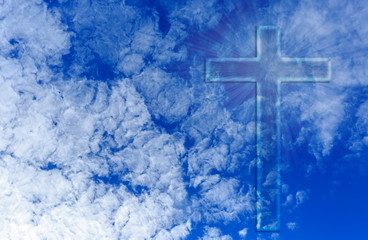 christian cross in a blue sky with some clouds