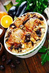 Chicken thigh baked with rice, eggplant and figs