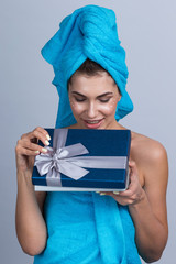 Woman open beauty gift