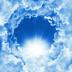 Peaceful cloudy sky natural background. Sky with beautiful cloud and sunshine. Sunny day. Religion concept heavenly background. Divine shining heaven, light