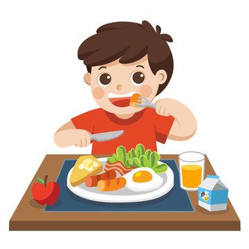 A little boy happy to eat breakfast in the morning.
