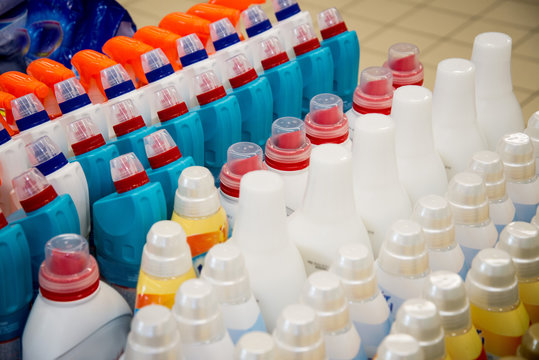 Color plastic bottles in a row.