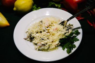 salad with mushrooms, vegetables and shredded cheese