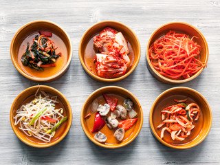 top view of various appetizer in ceramic bowls