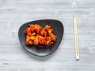Kkanpunggi fried Chicken with chopsticks on table