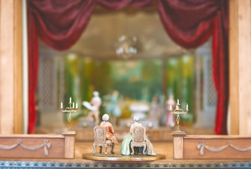 Miniature toys watching theater performance