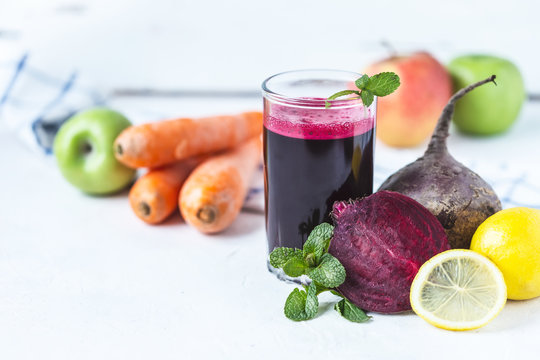fresh juice from homemade vegetables. Beet smoothie. Detox, vegetarianism On a bright summer background