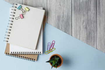 Notebook on a colored background with paper clips