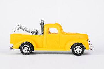 Auto toy yellow retro wrecker pickup